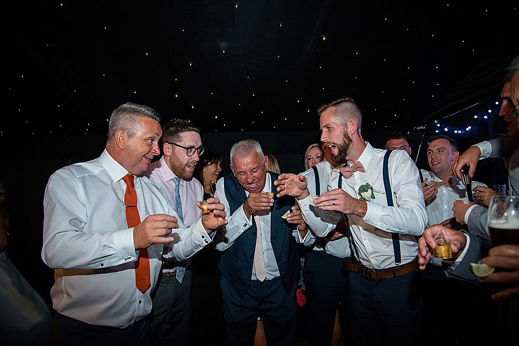 wedding party drinking shots in the evening