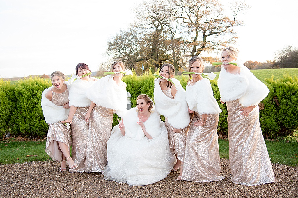 girls just wanna have a bit of fun on a wedding day, bride with her bridesmaids