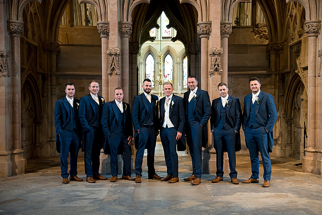 Groomsmen wedding party, in a church all suited up to impress