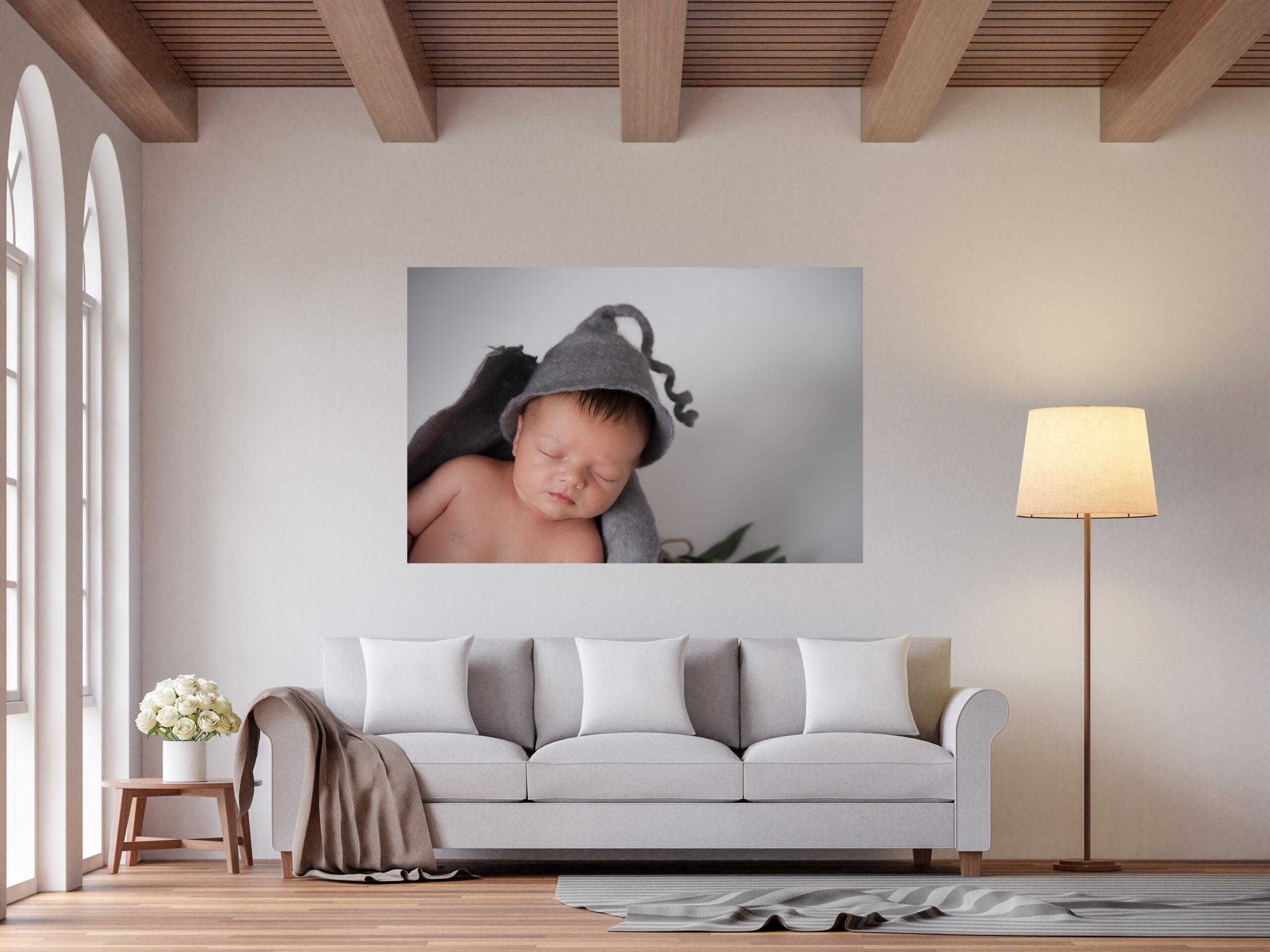 newborn baby boy, grey hat and fast asleep