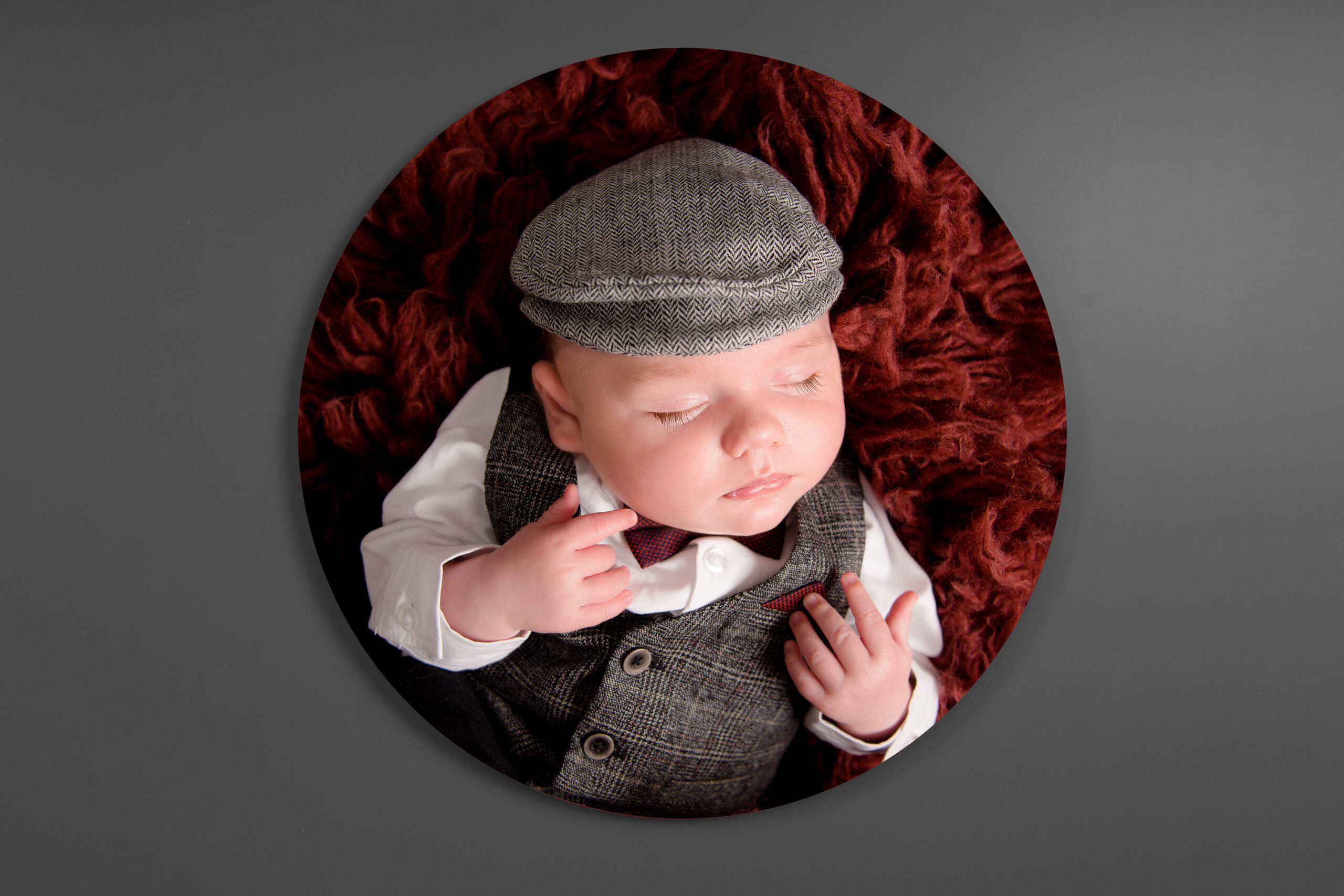 baby boy with cap on, printed on a circle acrylic