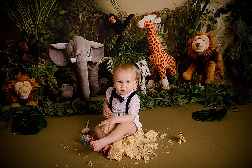 birthday boy at his cake smash session at rachael phillips photography in Mansfield, Nottinghamshire