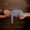 baby boy in his parents hands at his newborn session at rachael phillips photography in Mansfield, Nottinghamshire