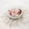 digital background - little baby girl in a bowl with white fluff