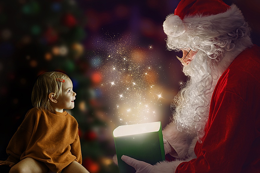 christmas backdrop with santa, abox and a little surprised girl