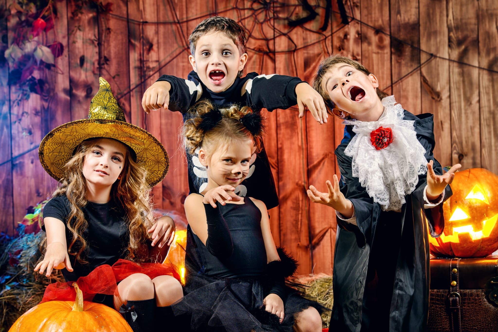 kids all dressed up for halloween photo shoot